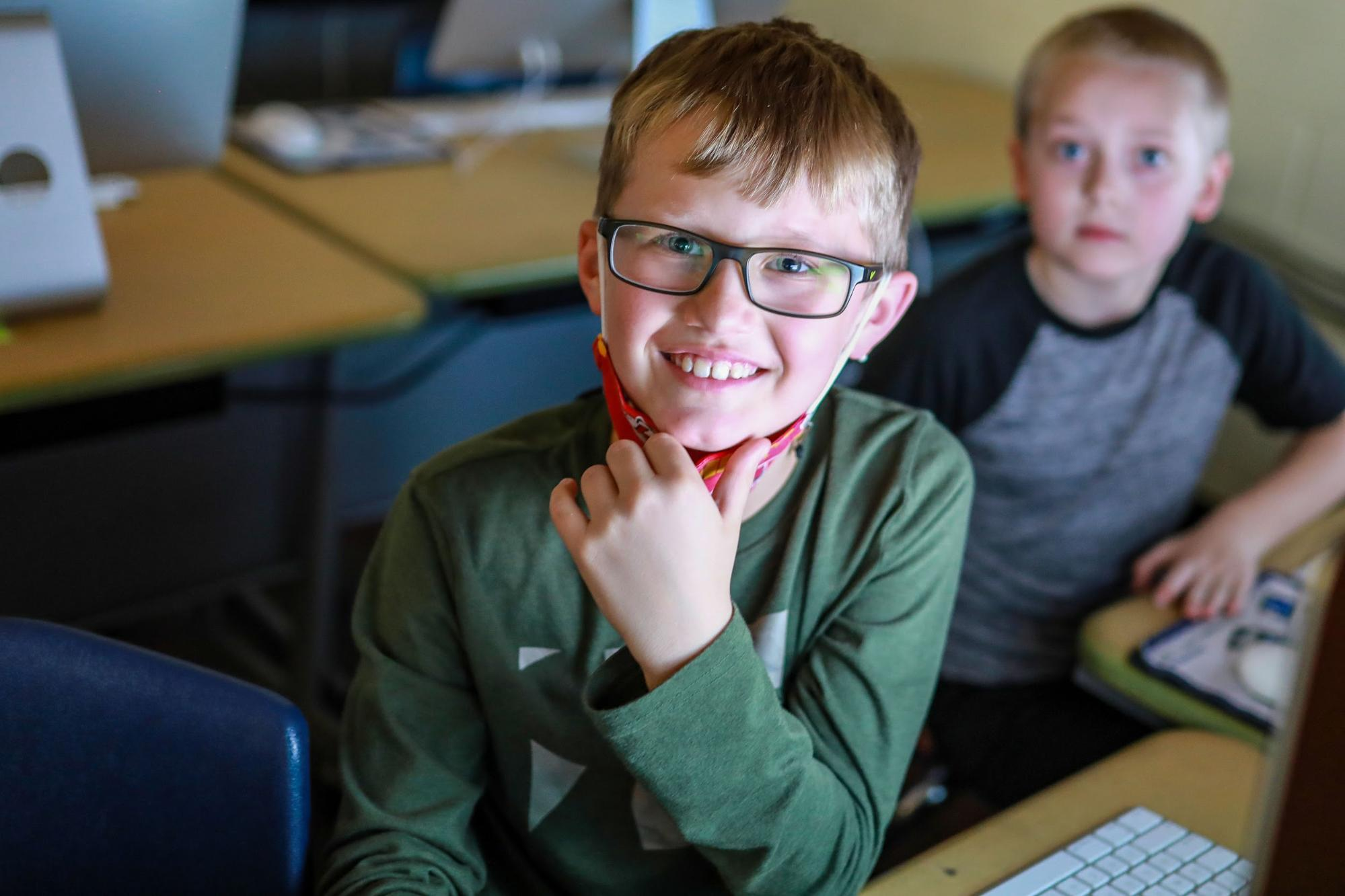 Elementary student smiling in a computer lab