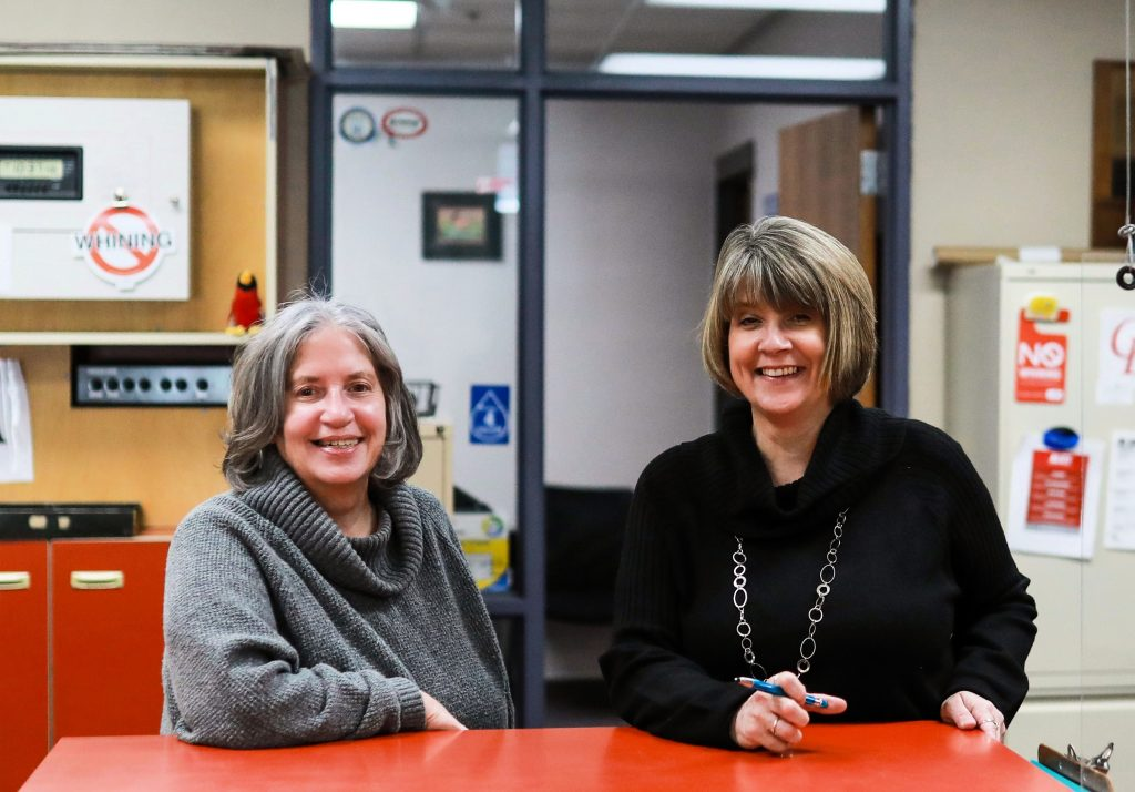 High school office staff welcome visitors