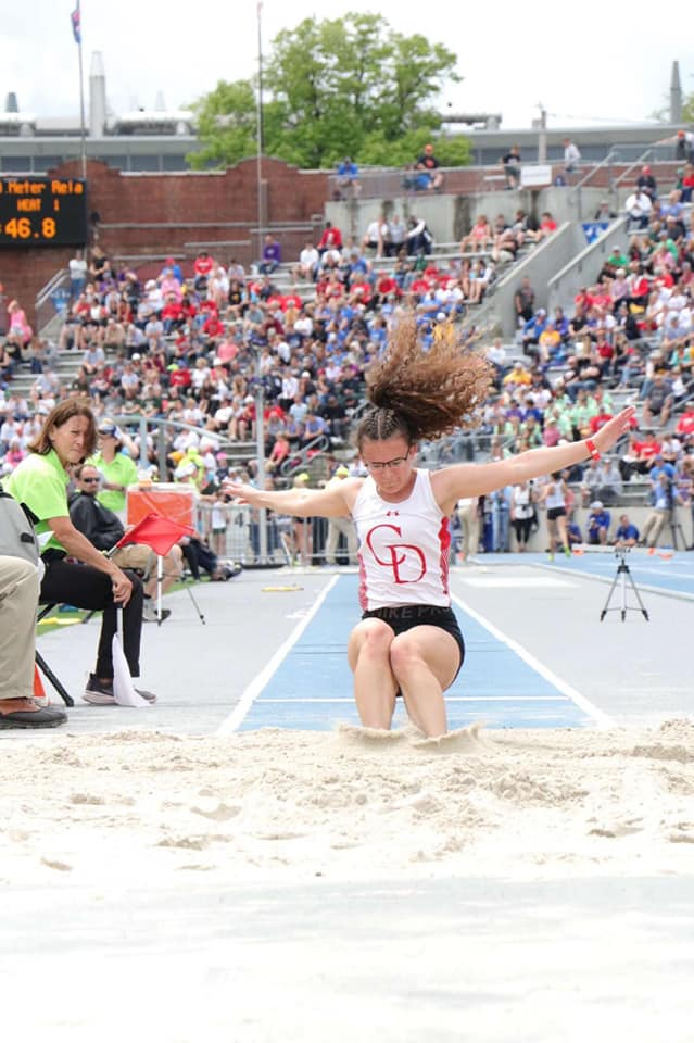 Chloe Hamaker long jumping at the State Tournament.