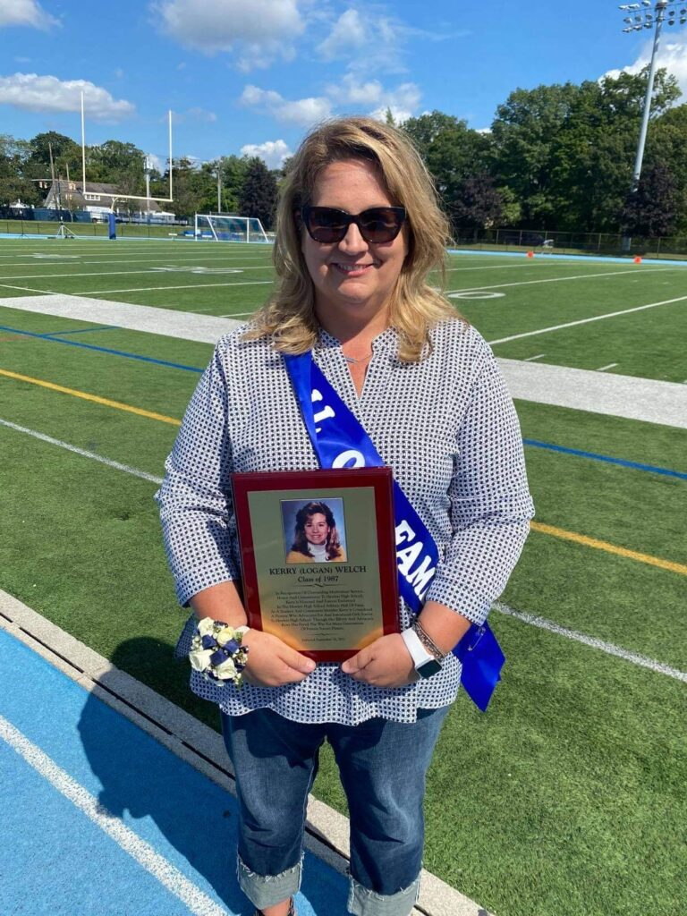 Kerry Welch holds her Hall of Fame plaque