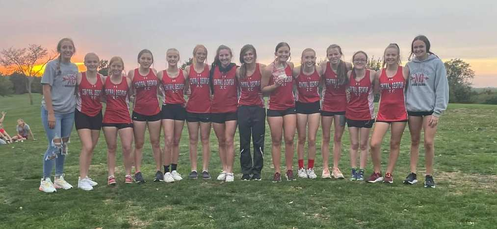 14 Girls Pose in a Team Photo after the Cross Country Team won the conference champioinship