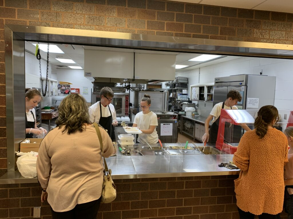Advanced culinary arts students serve the all music night meal.