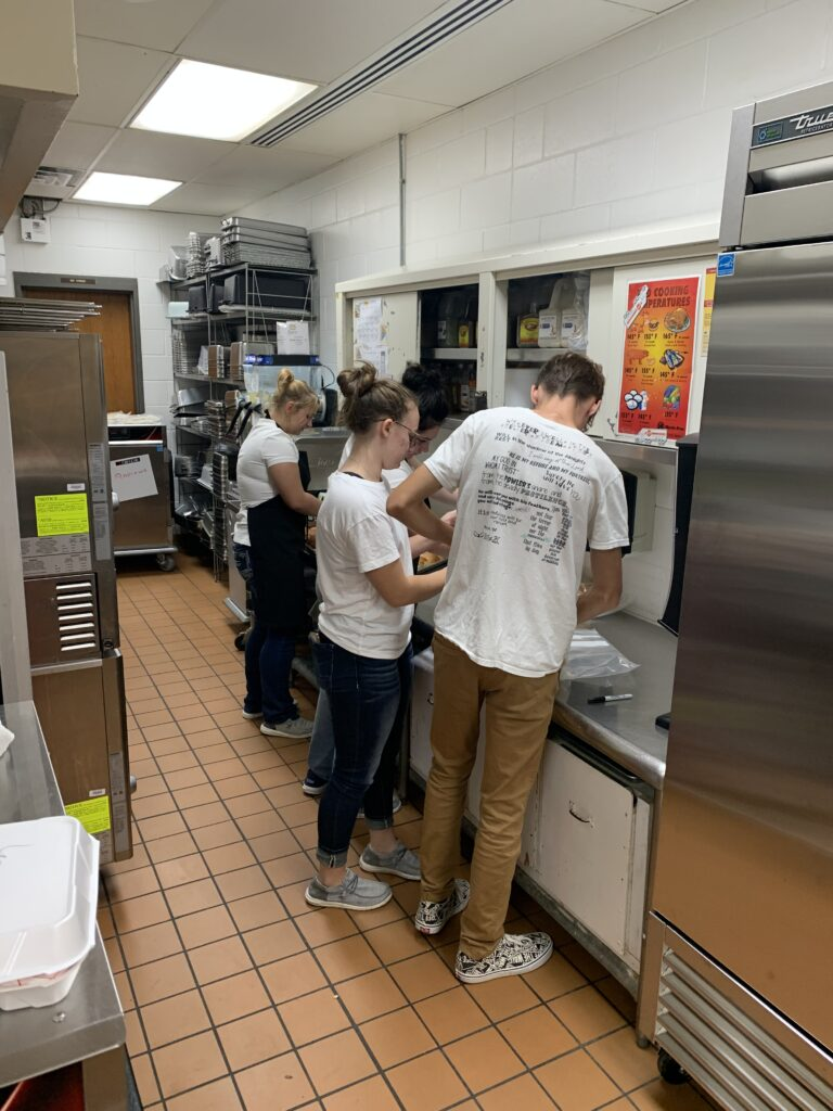 advanced culinary arts students prepare the all music night meal