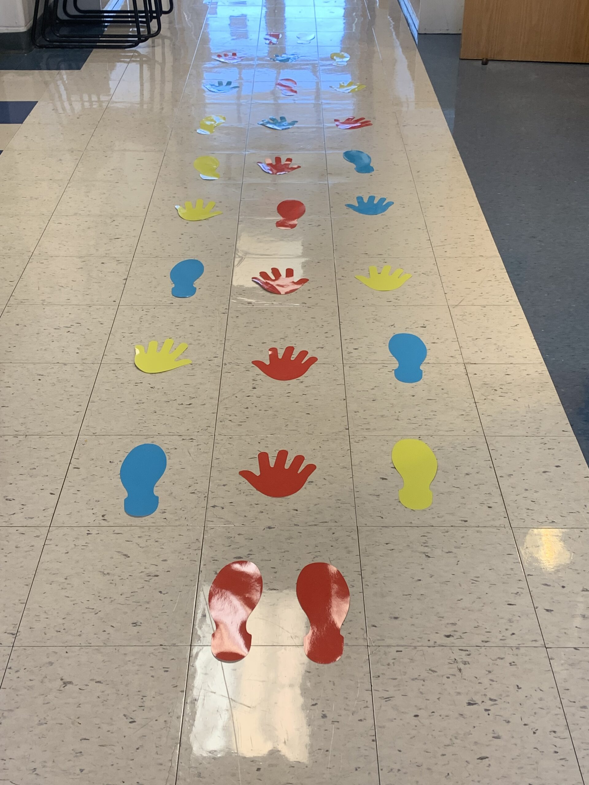hand and footbprints create a sensory pathway in the hall at South Elementary