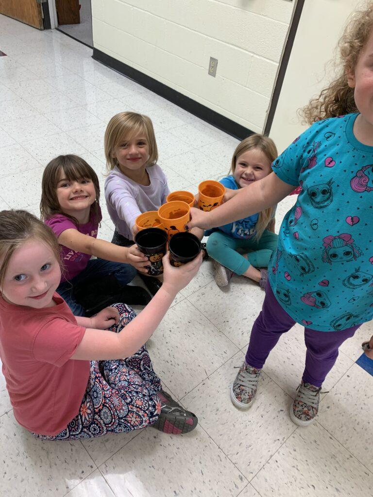 five students celebrate RED way behavior with lemonade