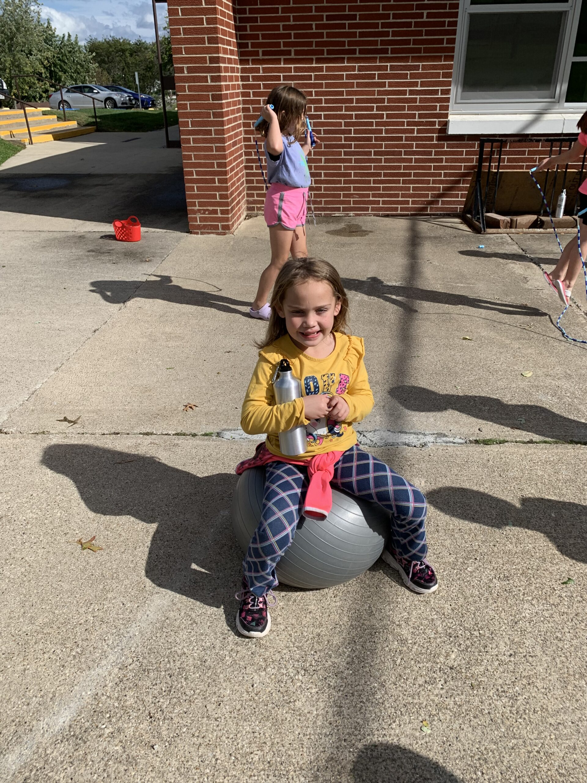 Two South Elementary Students enjoy a lemonade recess to celebrate RED Way behavior