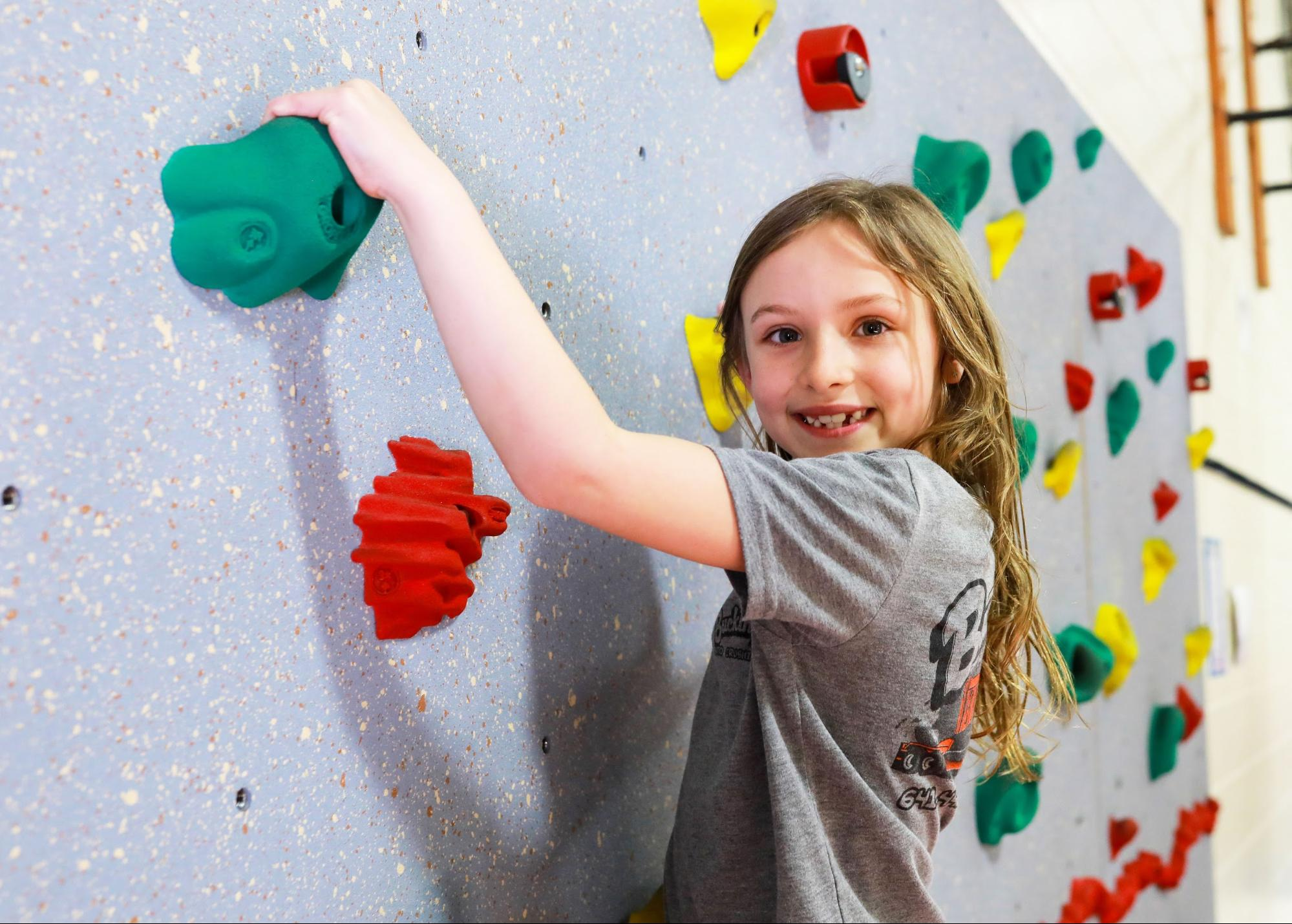 Elementary student on a climbing wall
