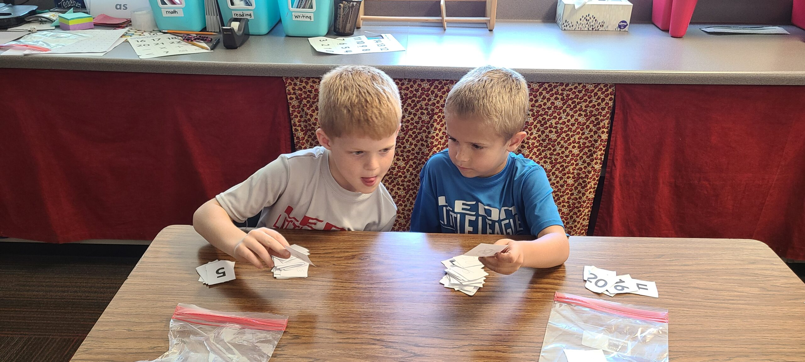 Two first grade math students practice counting with a game.